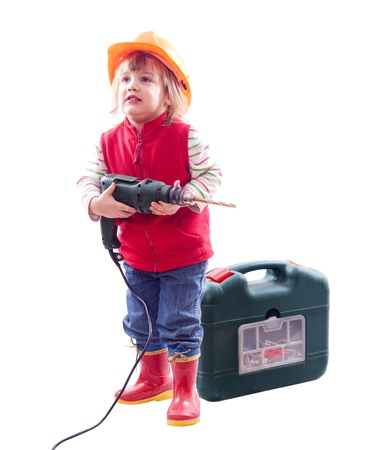 2 years child in hardhat with drill and tool box. Isolated over white photo