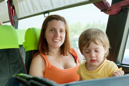 motorbus: woman with her child in bus cabin Stock Photo