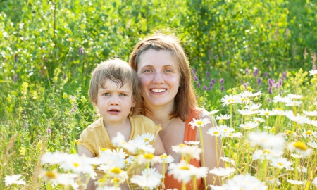 Happy mother with daughter in summer daisy plant Stock Photo - 21897476