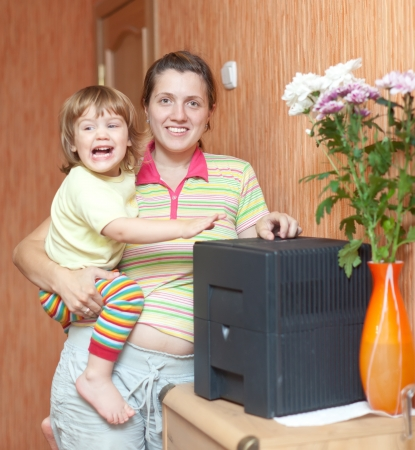 humidifier: mother and daughter uses humidifier at home  Stock Photo