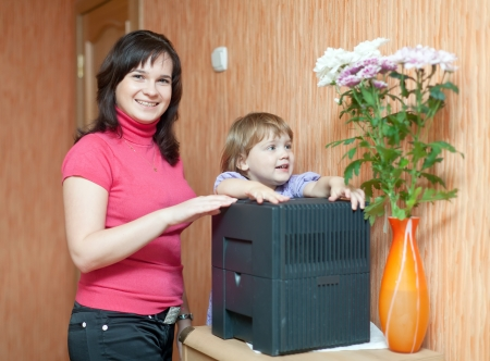 humidifier: Woman and child uses humidifier at home