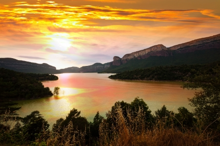 view of mountains lake in sunset. Sau reservoir. Catalonia