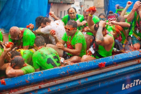 BUNOL, SPAIN - AUGUST 28:  Tomatina festival in August 28, 2013 in Bunol, Spain. Fighters in truck with tomatoes