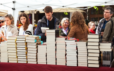 BARCELONA, CATALONIA - APRIL 23: Books on stalls in Sant Jordi in April 23, 2013 in Barcelona, Catalonia. Saint George is the patron saint of city. Focus on book