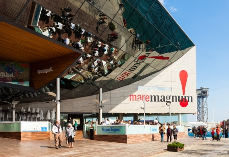 moll: BARCELONA, SPAIN - MARCH 28: Maremagnum commercial centre in March 28, 2013 in Barcelona, Spain. It is modern shopping centers at Port Vell area
