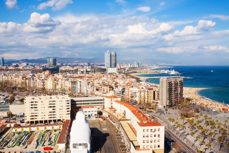 view of picturesque metropolitan area with sea beach in cloudy day. Barcelona, Spain photo