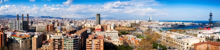columb: Panorama of Barcelona with Port Vell from Montjuic hill in cloudy day. Catalonia, Spain