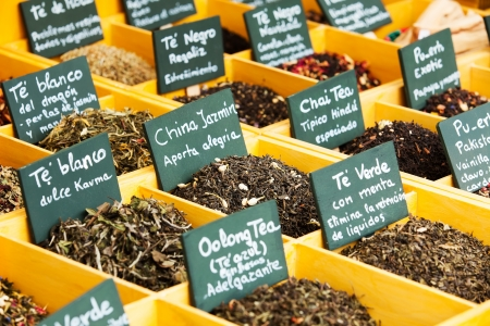 herbs and tea at counter in  market photo