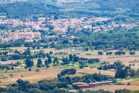 selva: Top view of typical Catalan town. Breda, Catalonia Stock Photo