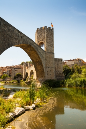 Medieval bridge wuth gate. Besalu, Catalonia photo