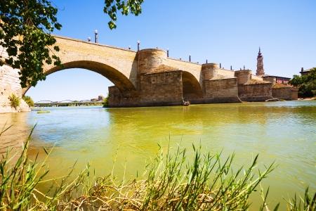 Puente de Piedra at Zaragoza in sunny day. Aragon photo
