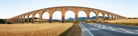 acueducto: Panorama of Noain aqueduct near Pamplona. Navarre, Spain Stock Photo