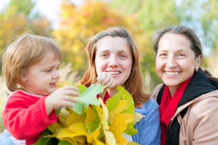 Portrait of three generations in the autumn park Stock Photo - 22074366