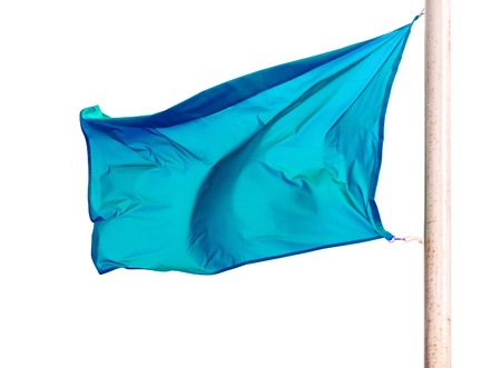 waving blue flag. Isolated over white  photo