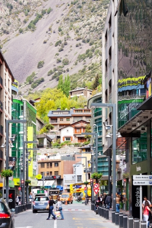tourism in andorra: ANDORRA LA VELLA, ANDORRA - MAY 8: Street with shops of Andorra la Vella in May 8, 2013 in Andorra la Vella, Andorra. City located in the east Pyrenees and famous for its duty-free shops