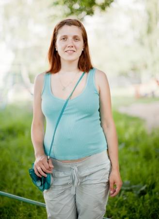 gravida: Portrait of pregnancy woman against  sunner park