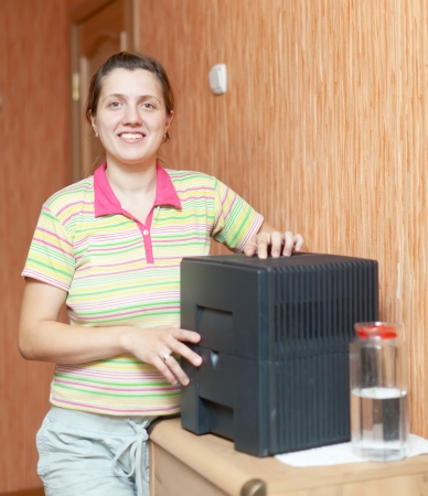 ionizing:  Woman uses humidifier at home