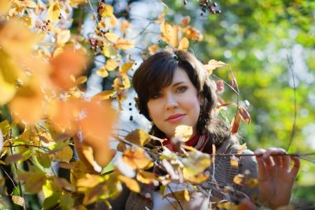 happy seasonable: Outdoor portrait of girl at autumn park