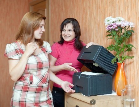ionizer: Two women uses humidifier  at home