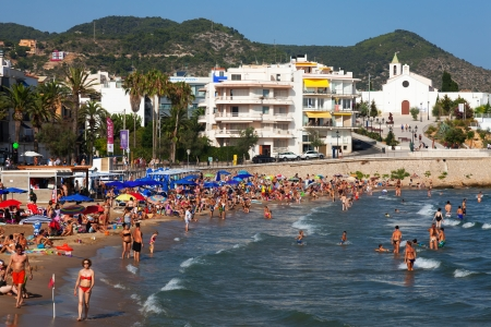 SITGES, SPAIN - AUGUST 6: Summer view of Sitges in August 6, 2013 in Sitges, Spain.  Resort town known for its sandy beach