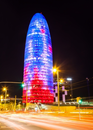 BARCELONA, SPAIN - APRIL 12: Night view of Torre agbar in April 12, 2013 in Barcelona, Spain. Skyscraper, built in 1999-2005 by Jean Nouvel. Now one of the symbols of Barcelona is owned by Grupo Agbar