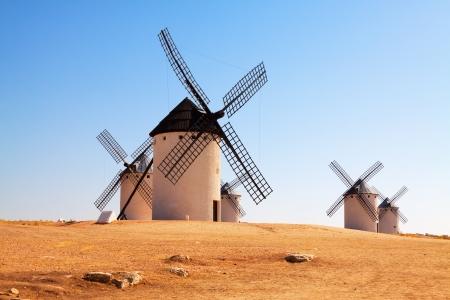 windmills in field. La Mancha, Spain photo