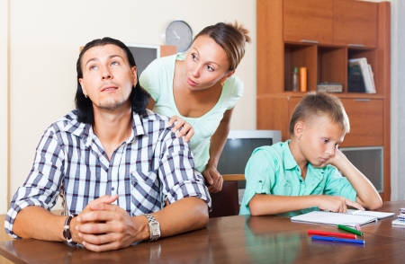 Family with teenager boy having quarrel at home photo