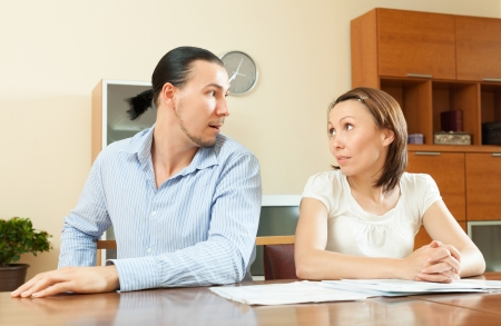 covetous: husband and wife having a financial problems about documents