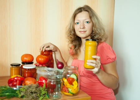 preserving: Woman with marinated vegetables in the kitchen Stock Photo