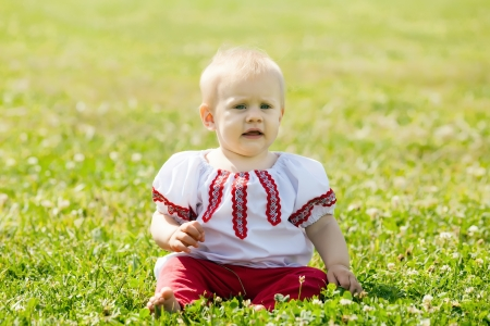 toddler in traditional folk clothes   photo