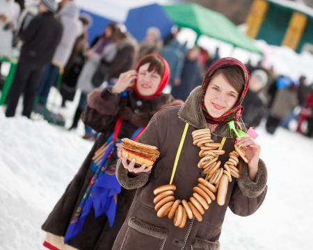sudarium: Women  in traditional  clothes with pancake during  Maslenitsa festival