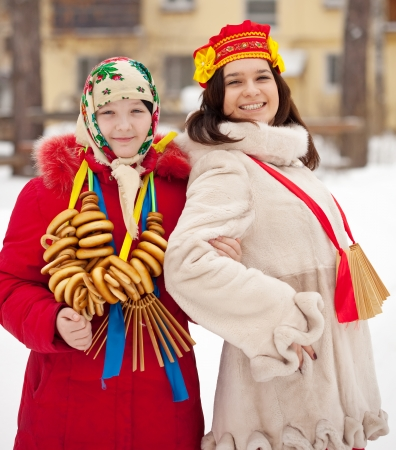 Two happy girls celebrating  Shrovetide  at Russia photo