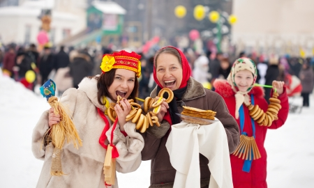 happy women celebrating  Pancake Week at Russia photo