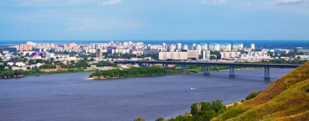 residential settlement: panoramic view of  residential district at Nizhny Novgorod with Metro Bridge through Oka in summer. Russia