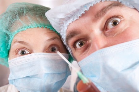 close up shot of two doctors with syringe  photo