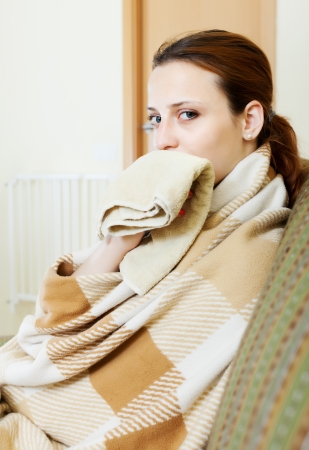 illness woman in warm plaid with handkerchief Stock Photo - 22700304