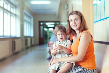 paediatrics: woman with child waits to doctor receive at the clinic