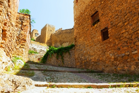 City wall of Albarracin on sunny summer day. Aragon, Spain photo