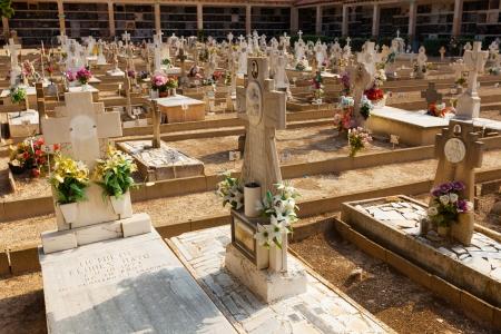 gravesite: TERUEL, SPAIN - AUGUST 25: Spanish сhristianity gravesite in August 25, 2013 in Teruel, Spain.  Day view of cemetery in Teruel