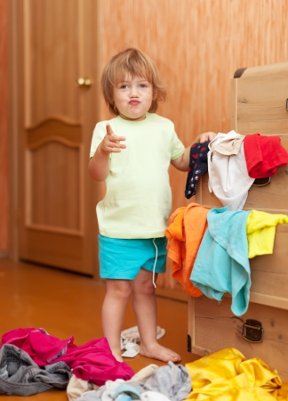 scallywag: Baby girl at wardrobe. She thinking what get dressed Stock Photo