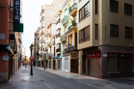 olden day: CASTELLON DE LA PLANA, SPAIN - AUGUST 25: City street of  Castellon on August 25, 2013 in Castellon de la Plana, Spain. City is located  in the east of Iberian Peninsula. Population (2012): 180,204