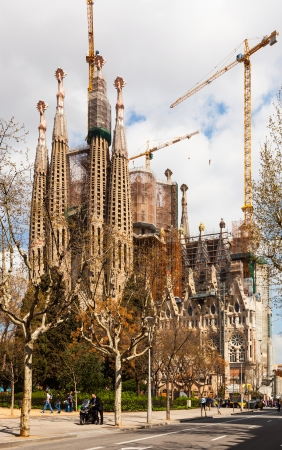 uncomplete: BARCELONA, SPAIN - MARCH 28: Sagrada Familia in March 28, 2013 in Barcelona, Spain. Famous Church in spring, building is begun in 1882 and completion is planned in 2030