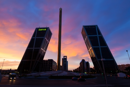MADRID, SPAIN - AUGUST 28: La Puerta de Europa in dusk on August 28, 2013 in Madrid, Spain. Monument to Calvo Sotelo, Caja Madrid Obelisk and KIO towers