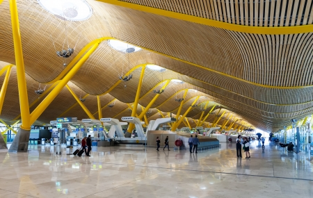 barajas: MADRID, SPAIN - APRIL 26: Interior of Barajas Airport in April 26, 2013 in Madrid, Spain. Interior of Terminal 4, designed by Antonio Lamela and Richard Rogers
