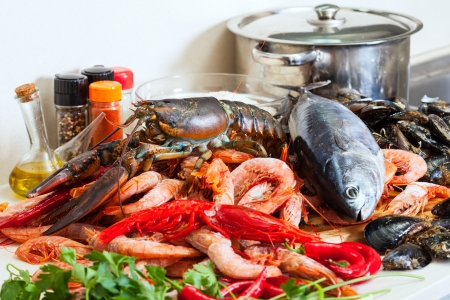 nutricion: Still life with fresh raw marine products at cooking table Stock Photo