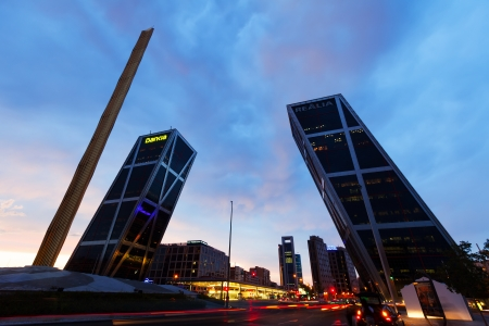 MADRID, SPAIN - AUGUST 28: Gate of Europe in evening on August 28, 2013 in Madrid, Spain. Monument to Calvo Sotelo, Caja Madrid Obelisk and KIO towers