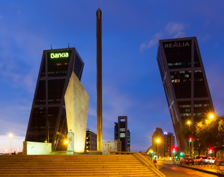 MADRID, SPAIN - AUGUST 28: Plaza de Castilla in evening on August 28, 2013 in Madrid, Spain. Monument to Calvo Sotelo, Caja Madrid Obelisk and KIO towers