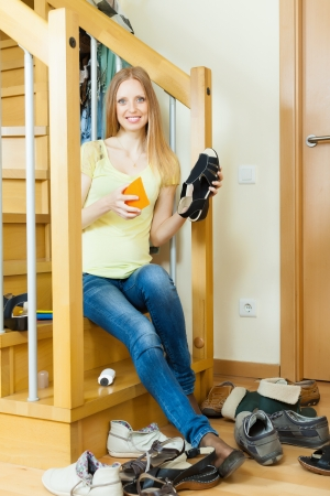 Happy Long-haired housewife with shoes at home photo