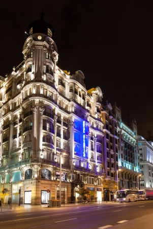 gran via: MADRID, SPAIN - APRIL 26: Evening view of Gran Via street in April 26, 2013 in Madrid, Spain. Gran Via one of broadest and most important avenues at city