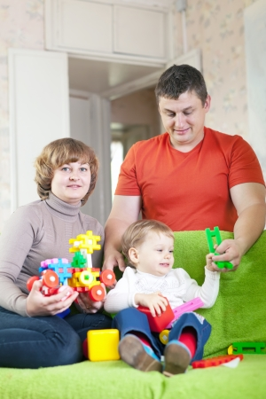 Happy family plays in home interior Stock Photo - 23162622